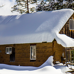 Cabin With Snow on Roof