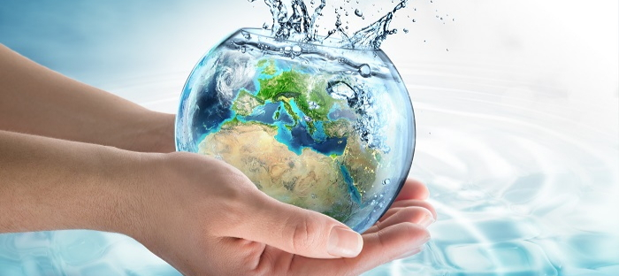 hands holding a water-filled globe