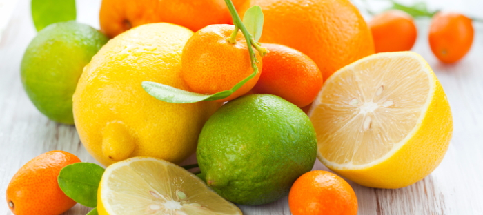 An assorted pile of citrus fruits.