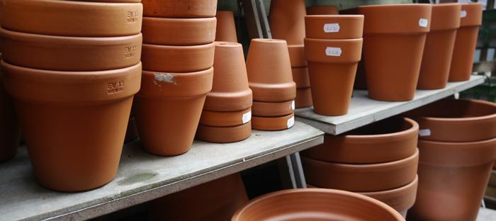 stacks of terra cotta pots on shelves