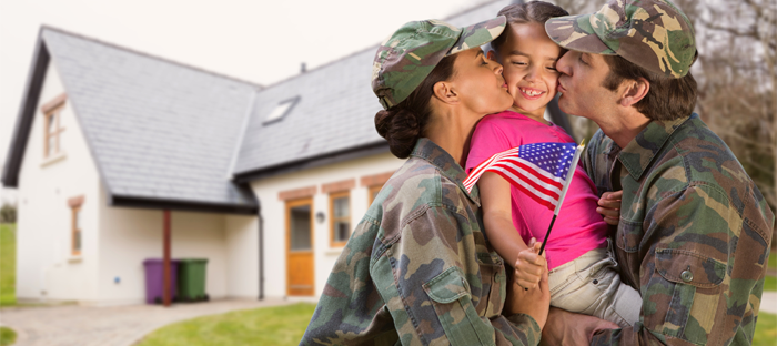 Two uniformed parents holding and kissing a small child