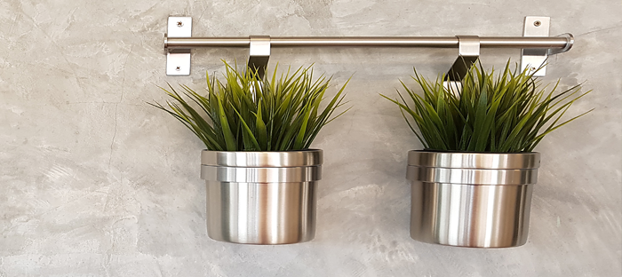Two Stainless Steel Planter Pots Mounted on Concrete Wall
