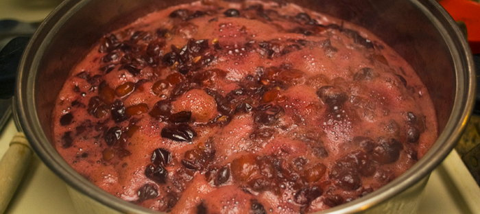 Concord grapes boiling in stock pan