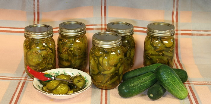 pickles in jars and fresh cucumbers
