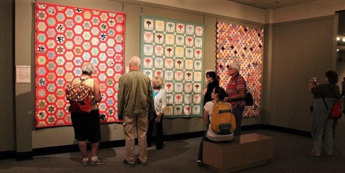 visitors looking at quilt display