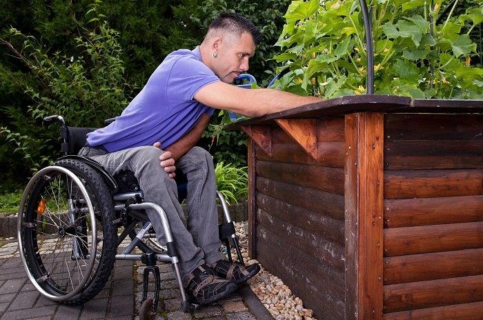 man gardening from a wheelchair