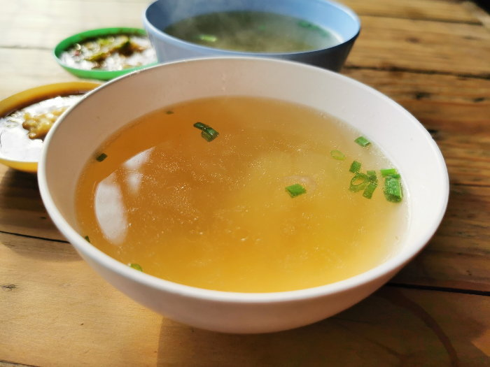 broth in a bowl with seasonings