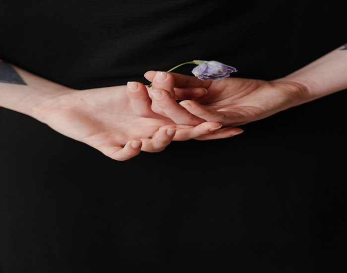 lover's hands with larkspur