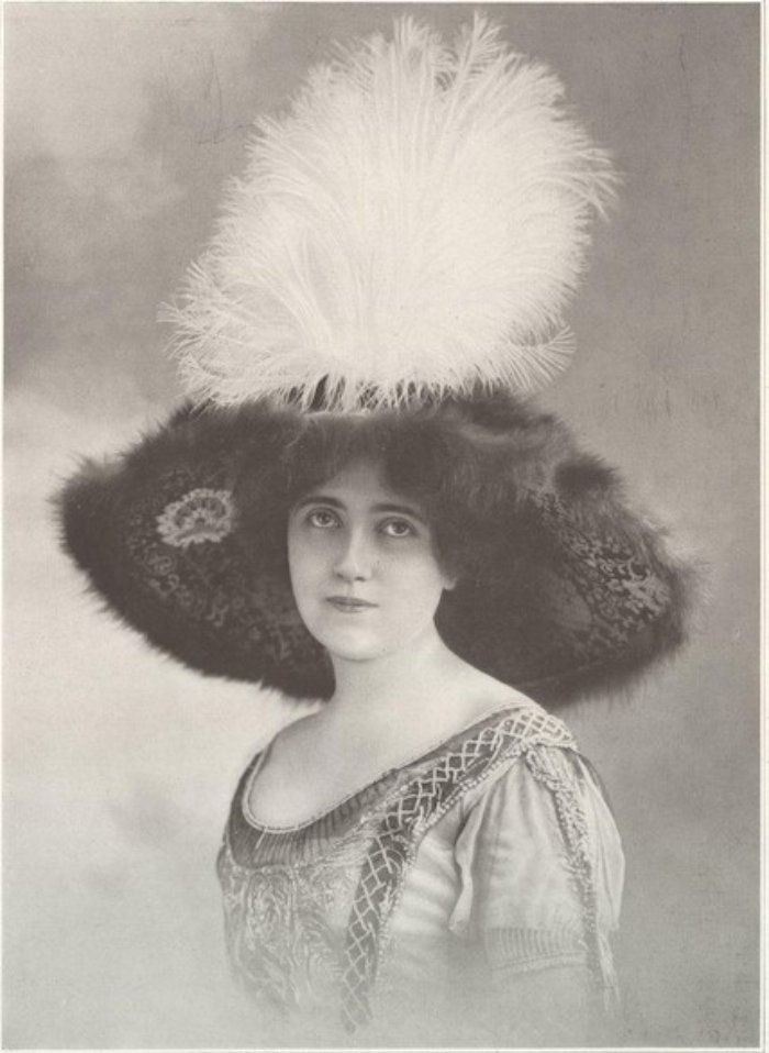 portrait of woman with fancy feathered hat