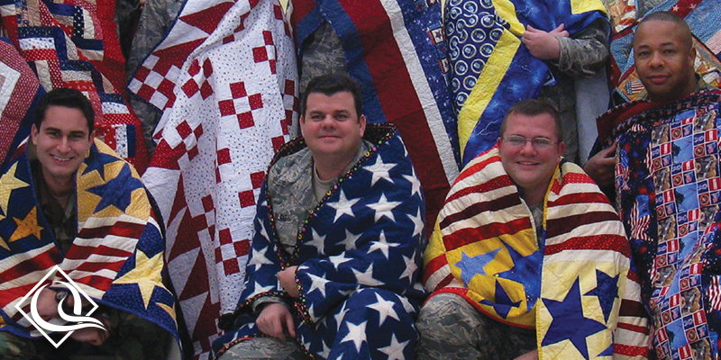 young veterans wrapped in their quilts of Valor