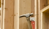 Hammering a door frame into place