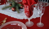 Several pieces of etched glassware in a holiday table setting.