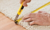 someone measuring and cutting carpet