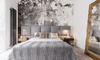 small space bedroom with large mirror and gray art design on wall