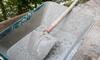concrete and shovel in a wheelbarrow