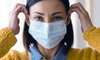 woman wearing surgical face mask