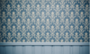 Blue and tan wallpaper on a wall
