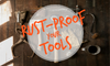 """A layout of rusty tools with an overlay stating """"rust-proof your tools."""""""