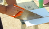 hand slicing tile with a panel hacksaw