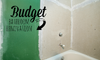 """A bathroom remodeling project with the words """"budget bathroom renovation."""""""
