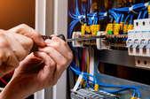A technician works on a circuit breaker.