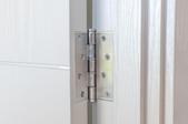 hinge on a white door