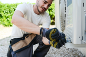 Repairman working on an air conditioner