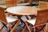 stained wooden outdoor chairs and table