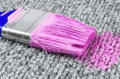 a carpet with a pink paintbrush on it