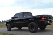 black pickup on the road