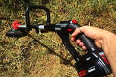 Person using a string trimmer