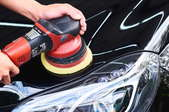 polishing a black car
