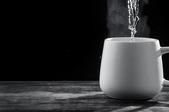 steam rising out of a mug