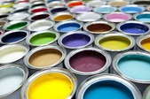 Cans containing various colors of paint.