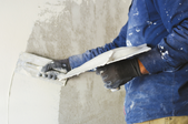 Man plastering a wall