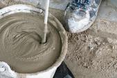 A man mixes concrete.