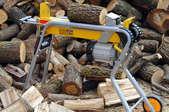 log splitter and pile of wood