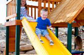 child going down a slide