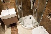tiled walls and flooring in bathroom