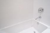 a white built-in bathtub