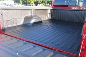 red truck with a sprayed in bed liner