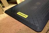 Stanley utility mat on floor of workshop