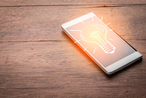A smart phone with a light bulb illustration