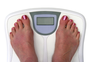 A person standing on a digital bathroom scale.