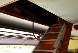A ladder leading up to an above-garage attic.