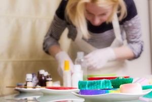 Woman working with soap and essential oils