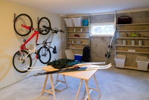 basement with bikes, skis, and a window