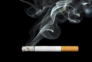 A cigarette on a black background.