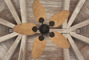 A view looking up at a rustic wood ceiling with a bamboo ceiling fan.