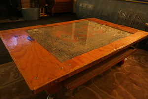 A rolling coffee table built from scrap and an ornamental carpet.